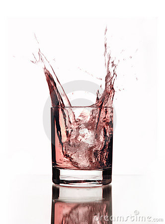 A beautiful splash of pink water in a glass