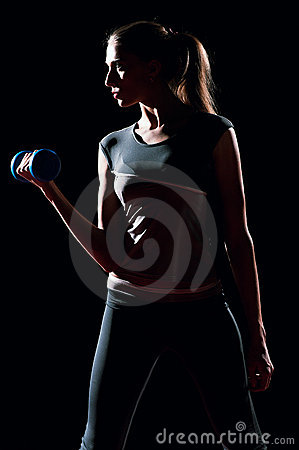 Beautiful sport woman doing power fitness exercise