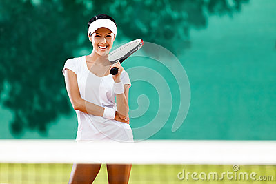 Beautiful sportswoman with racquet
