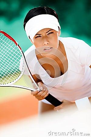 Beautiful sportswoman in sportswear playing tennis