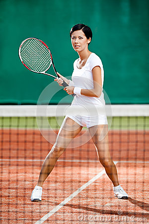 Beautiful sportswoman at the tennis court