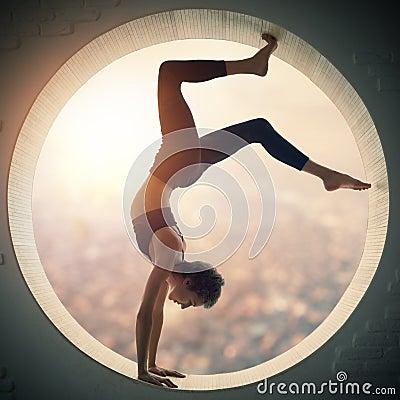 Free Beautiful Sporty Fit Yogi Woman Practices Yoga Handstand Asana Bhuja Vrischikasana - Scorpion Handstand Pose In A Window Royalty Free Stock Image - 101307306