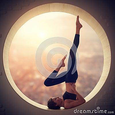 Free Beautiful Sporty Fit Yogi Woman Practices Yoga Salamba Sarvangasana - Shoulderstand Pose In A Window Stock Image - 101325241
