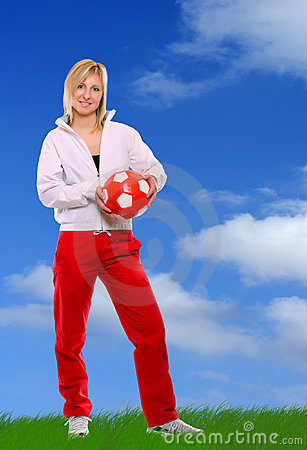 Beautiful sporty girl with soccer ball.