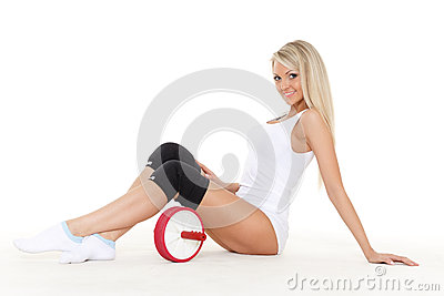 Sporty woman with roller slider. Fitness.