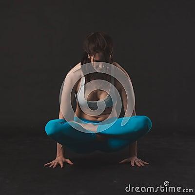 Free Beautiful Sporty Yogi Girl Practices Yoga Asana Stock Image - 70270651