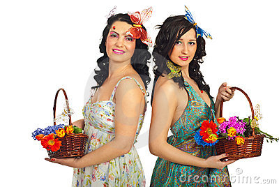 Beautiful spring women holding flowers