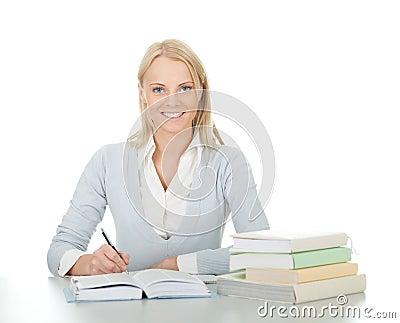 Beautiful student girl doing homework