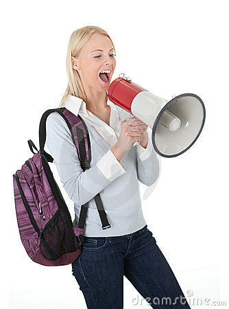 Beautiful student girl shouting in megaphone