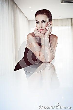 Beautiful stylish woman in glamour dress