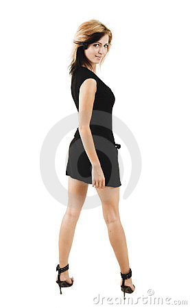 Beautiful stylish woman posing in a cute black dress