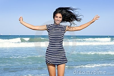 Beautiful summer girl jumping on the beach