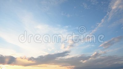 A beautiful summer sky with clouds in the sunset stock video footage