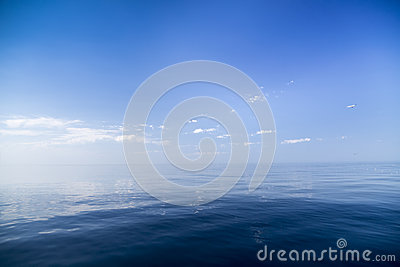 Beautiful sunny day with blue sky over the sea. Stock Photo