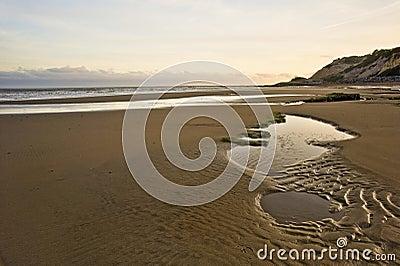 Beautiful sunrise landscape over sandy beach