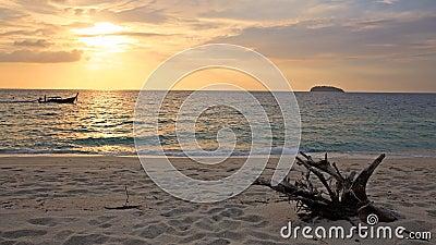 Beautiful sunrise over Andaman sea and sailing boat