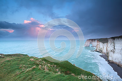 Beautiful sunrise over cliffs in Atlantic ocean