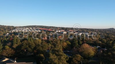 Beautiful sunrise over a suburb. A dolly up of a beautiful sunrise over the Randburg suburb in South Africa stock footage