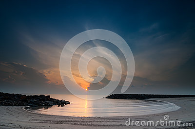 Beautiful sunrise with sea wall on faita beach Stock Photo