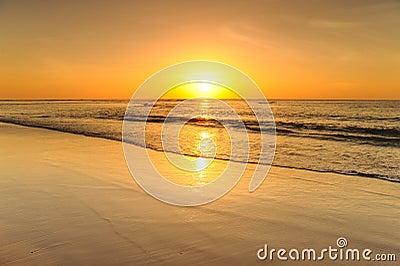 Beautiful sunset above the sea on the beach
