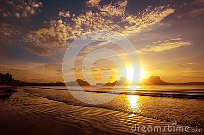 Beautiful sunset on the beach amid the islands with the setting