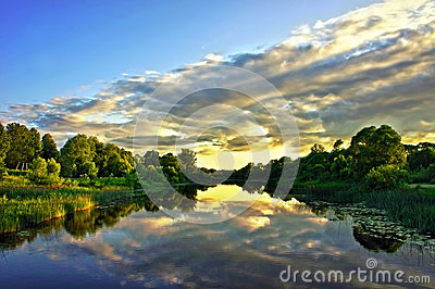 Beautiful Sunset Landscape with reflection on River Sky and Clouds