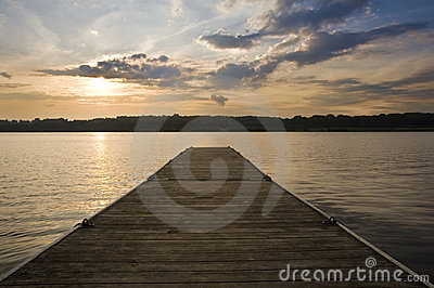 Beautiful sunset over lake landscape with jetty