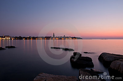 Beautiful sunset with the Porec town skyline
