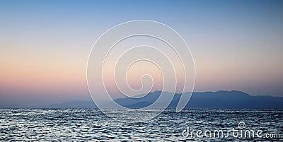 Beautiful sunset on sea and mountain