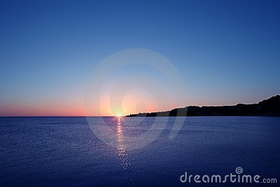 Beautiful Sunset Sunrise Over Blue Sea Royalty Free Stock Photo - Image: 12865345