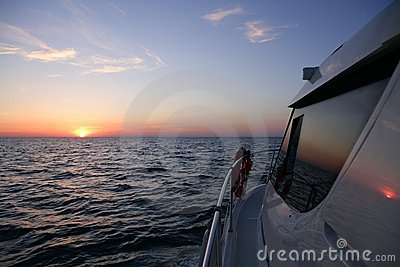 Beautiful sunset sunrise over blue sea  in a yacht