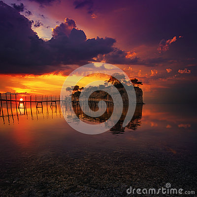 Free Beautiful Sunset With Rocky Island Royalty Free Stock Photography - 59482297