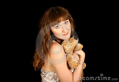 Beautiful sweet girl with a bear in the hands