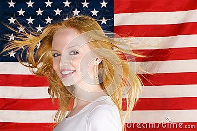 Beautiful teen girl against american flag