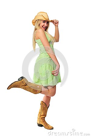 Beautiful teen girl with hat and boots