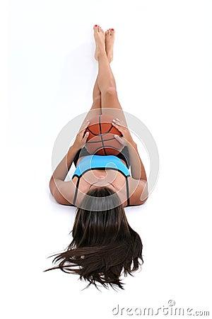 Beautiful Teen Girl Laying On Floor Holding Basket Ball