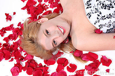 Beautiful Teen Girl Laying On Rose Petal Over White