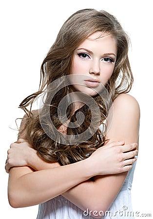 Beautiful teen girl with  long curly hairs