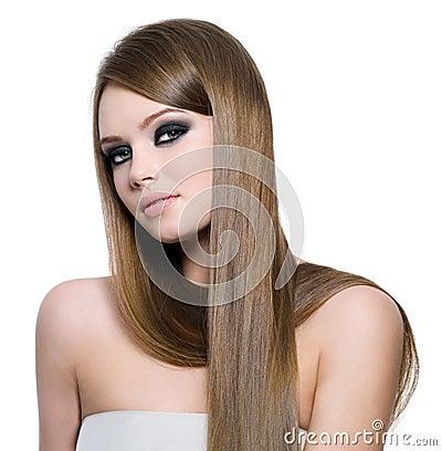 Beautiful teen girl with long straight hair