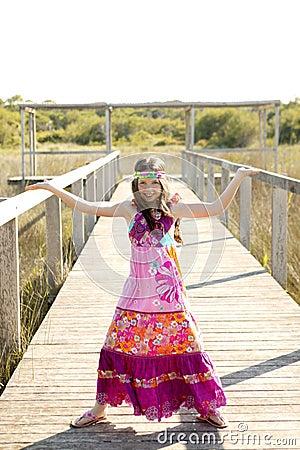 Beautiful teen girl with pink purple flower dress