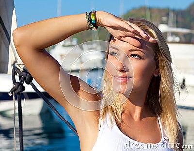 Beautiful teen girl sailing