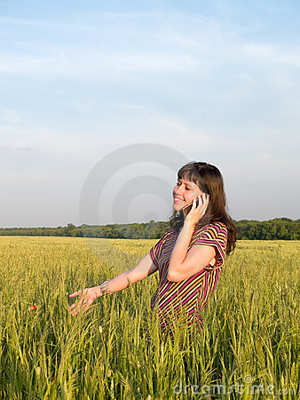 Beautiful Teen Girl Talking Mobile Phone Field