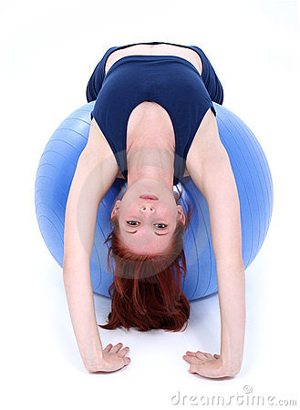 Beautiful Teenage Girl Back Stretch Over Exercise Ball