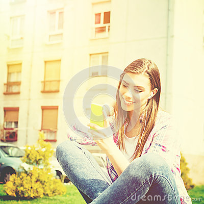 Free Beautiful Teenage Girl In Park With Smart Phone Listening To Music Stock Photography - 41007522