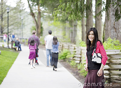 Beautiful teenage girl out on walk with family