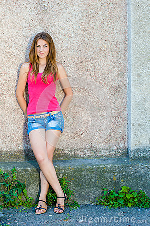 Free Beautiful Teenage Girl Standing At Concrete Wall On Summer Day Copy Space Stock Photos - 37245863
