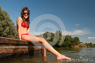 Beautiful teenage girl sunbathing on the boat