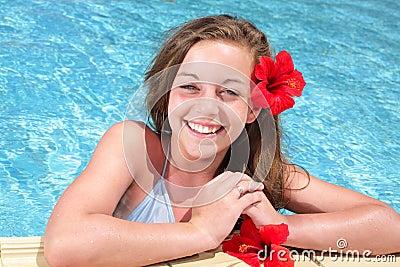 Beautiful teenage girl in swimming pool