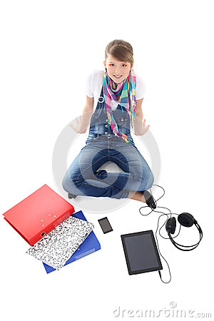 Beautiful teenage girl with tablet pc, phone and headphones
