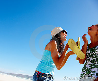 Beautiful teenage girls laughing at the beach